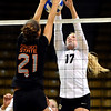 """University of Colorado's Michelle Miller tries unsuccessfully to stop a kill from Tayla Woods on Saturday, Sept. 24, during a volleyball game against the Oregon State Beavers at the Coors Event Center on the CU campus in Boulder. For more photos of the game go to  <a href=""""http://www.dailycamera.com"""">http://www.dailycamera.com</a><br /> Jeremy Papasso/ Camera"""