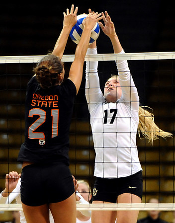 "University of Colorado's Michelle Miller tries unsuccessfully to stop a kill from Tayla Woods on Saturday, Sept. 24, during a volleyball game against the Oregon State Beavers at the Coors Event Center on the CU campus in Boulder. For more photos of the game go to  <a href=""http://www.dailycamera.com"">http://www.dailycamera.com</a><br /> Jeremy Papasso/ Camera"