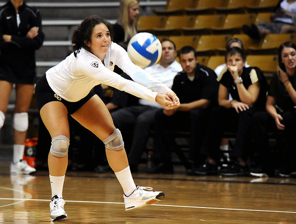 "University of Colorado's Elysse Richardson saves the ball on Saturday, Sept. 24, during a volleyball game against the Oregon State Beavers at the Coors Event Center on the CU campus in Boulder. For more photos of the game go to  <a href=""http://www.dailycamera.com"">http://www.dailycamera.com</a><br /> Jeremy Papasso/ Camera"