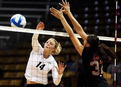University of Colorado's Emily Alexis goes for a kill over Ashley Eneliko on Saturday, Sept. 24, during a volleyball game against the Oregon State Beavers at the Coors Event Center on the CU campus in Boulder. For more photos of the game go to www.dailycamera.com Jeremy Papasso/ Camera