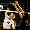 "University of Colorado's Emily Alexis goes for a kill over Ashley Eneliko on Saturday, Sept. 24, during a volleyball game against the Oregon State Beavers at the Coors Event Center on the CU campus in Boulder. For more photos of the game go to  <a href=""http://www.dailycamera.com"">http://www.dailycamera.com</a><br /> Jeremy Papasso/ Camera"
