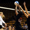 """University of Colorado's Nikki Lindow gets her shot blocked by Arica Nassar, middle, and Ashley Eneliko on Saturday, Sept. 24, during a volleyball game against the Oregon State Beavers at the Coors Event Center on the CU campus in Boulder. For more photos of the game go to  <a href=""""http://www.dailycamera.com"""">http://www.dailycamera.com</a><br /> Jeremy Papasso/ Camera"""