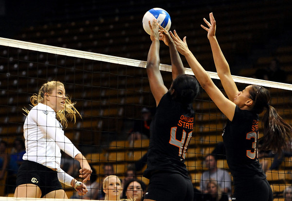 "University of Colorado's Nikki Lindow gets her shot blocked by Arica Nassar, middle, and Ashley Eneliko on Saturday, Sept. 24, during a volleyball game against the Oregon State Beavers at the Coors Event Center on the CU campus in Boulder. For more photos of the game go to  <a href=""http://www.dailycamera.com"">http://www.dailycamera.com</a><br /> Jeremy Papasso/ Camera"