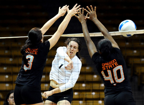 "University of Colorado's Kelsey English gets her shot rejected by Oregon State's Camille Saxton, left, and Arica Nassar on Saturday, Sept. 24, during a volleyball game against the Oregon State Beavers at the Coors Event Center on the CU campus in Boulder. For more photos of the game go to  <a href=""http://www.dailycamera.com"">http://www.dailycamera.com</a><br /> Jeremy Papasso/ Camera"