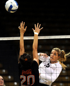 University of Colorado's Nikki Lindow kills the ball over Oregon's Allie Rogers on Saturday, Sept. 24, during a volleyball game against the Oregon State Beavers at the Coors Event Center on the CU campus in Boulder. For more photos of the game go to www.dailycamera.com Jeremy Papasso/ Camera