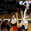 """University of Colorado's Kerra Schroeder goes for a kill over Arica Nassar, left, and Megan McBride on Saturday, Sept. 24, during a volleyball game against the Oregon State Beavers at the Coors Event Center on the CU campus in Boulder. For more photos of the game go to  <a href=""""http://www.dailycamera.com"""">http://www.dailycamera.com</a><br /> Jeremy Papasso/ Camera"""