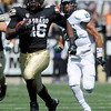 "University of Colorado's Christian Powell turns on the speed in front of Robert Beale while running in for touchdown during a game against Sacramento State on Saturday, Sept. 8, at Folsom Field in Boulder. For more photos of the game go to  <a href=""http://www.dailycamera.com"">http://www.dailycamera.com</a><br /> Jeremy Papasso/ Camera"