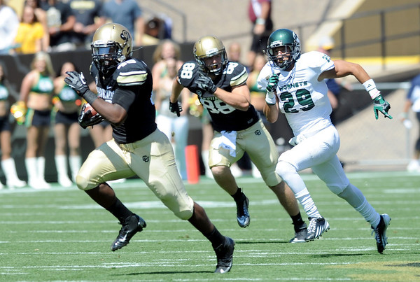 "Christian Powell of CU takes off for his first TD as a Buffalo against Sacramento State.<br /> For more photos of the game, got o  <a href=""http://www.dailycamera.com"">http://www.dailycamera.com</a>.<br /> Cliff Grassmick  / September 8, 2012"