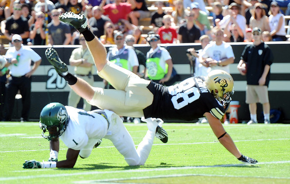 """Kyle Slavin of CU dives over Osagie Odiase of Sac State to score at TD.<br /> For more photos of the game, got o  <a href=""""http://www.dailycamera.com"""">http://www.dailycamera.com</a>.<br /> Cliff Grassmick  / September 8, 2012"""