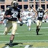"University of Colorado's Christian Powell runs in for a touchdown in the first quarter during a game against Sacramento State on Saturday, Sept. 8, at Folsom Field in Boulder. For more photos of the game go to  <a href=""http://www.dailycamera.com"">http://www.dailycamera.com</a><br /> Jeremy Papasso/ Camera"