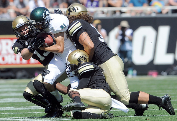 """University of Colorado's Parker Orms, left, and Jon Major, right, work together to tackle Blake Robertson during a game against Sacramento State on Saturday, Sept. 8, at Folsom Field in Boulder. For more photos of the game go to  <a href=""""http://www.dailycamera.com"""">http://www.dailycamera.com</a><br /> Jeremy Papasso/ Camera"""