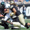 "University of Colorado's Parker Orms, left, and Jon Major, right, work together to tackle Blake Robertson during a game against Sacramento State on Saturday, Sept. 8, at Folsom Field in Boulder. For more photos of the game go to  <a href=""http://www.dailycamera.com"">http://www.dailycamera.com</a><br /> Jeremy Papasso/ Camera"