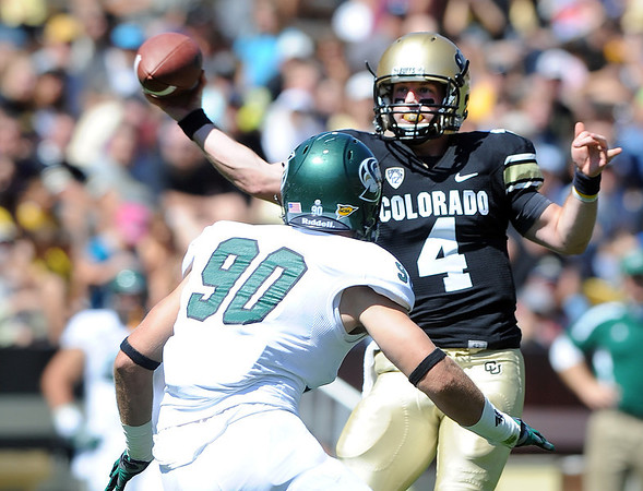 "CU's Jordan Webb tries to get a pass around Ben Cowger of Sacramento State.<br /> For more photos of the game, got o  <a href=""http://www.dailycamera.com"">http://www.dailycamera.com</a>.<br /> Cliff Grassmick  / September 8, 2012"