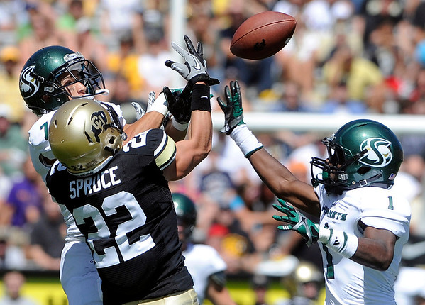 "University of Colorado's Nelson Spruce has a pass deflected by Joshua Armstrong, left, and Osagie Odiase during a game against Sacramento State on Saturday, Sept. 8, at Folsom Field in Boulder. Sacramento State won the game 30-28. For more photos of the game go to  <a href=""http://www.dailycamera.com"">http://www.dailycamera.com</a><br /> Jeremy Papasso/ Camera"