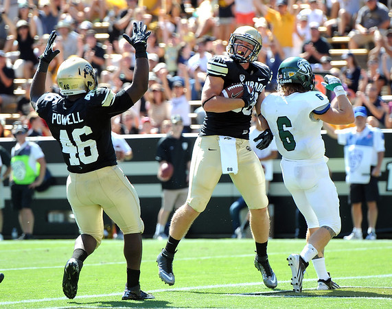 "Kyle Slavin of CU celebrates a TD catch with Christian Powell (46).<br /> For more photos of the game, got o  <a href=""http://www.dailycamera.com"">http://www.dailycamera.com</a>.<br /> Cliff Grassmick  / September 8, 2012"