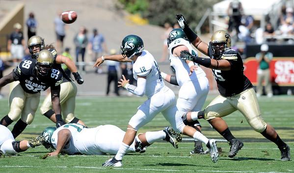 """Josh Tupou, right, of CU, pressures QB  Garrett Safron of Sacramento State.<br /> For more photos of the game, got o  <a href=""""http://www.dailycamera.com"""">http://www.dailycamera.com</a>.<br /> Cliff Grassmick  / September 8, 2012"""