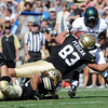 "University of Colorado's Will Pericak tackles Ezekiel Graham during a game against Sacramento State on Saturday, Sept. 8, at Folsom Field in Boulder. Sacramento State won the game 30-28. For more photos of the game go to  <a href=""http://www.dailycamera.com"">http://www.dailycamera.com</a><br /> Jeremy Papasso/ Camera"