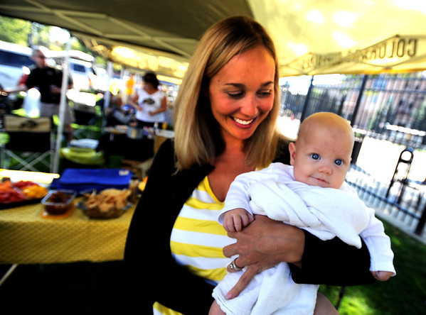 "Elizabeth Parsons of Broomfield, holds her daughter, Claire, 5-months, for her first CU tailgating party at Franklin Field on September 8, 2012.<br /> For more photos of the game, go to  <a href=""http://www.dailycamera.com"">http://www.dailycamera.com</a><br /> Cliff Grassmick / September 8, 2012"