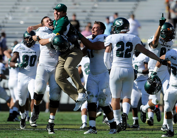 "Sacramento State's Vince Weaver, left, hugs his coach while celebrating victory over the University of Colorado on Saturday, Sept. 8, at Folsom Field in Boulder. Sacramento State won the game 30-28. For more photos of the game go to  <a href=""http://www.dailycamera.com"">http://www.dailycamera.com</a><br /> Jeremy Papasso/ Camera"