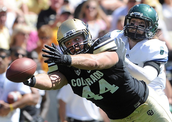 """University of Colorado's Nick Kasa barely misses a catch under Ryan McMahon's coverage during a game against Sacramento State on Saturday, Sept. 8, at Folsom Field in Boulder. For more photos of the game go to  <a href=""""http://www.dailycamera.com"""">http://www.dailycamera.com</a><br /> Jeremy Papasso/ Camera"""