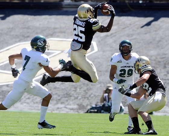 "University of Colorado's Gerald Thomas makes a leaping catch over Joshua Armstrong, No. 7, during a game against Sacramento State on Saturday, Sept. 8, at Folsom Field in Boulder. For more photos of the game go to  <a href=""http://www.dailycamera.com"">http://www.dailycamera.com</a><br /> Jeremy Papasso/ Camera"