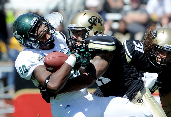 "Terrel Smith of CU, puts a hard hit on Chris Broadnax of Sac State.<br /> For more photos of the game, got o  <a href=""http://www.dailycamera.com"">http://www.dailycamera.com</a>.<br /> Cliff Grassmick  / September 8, 2012"