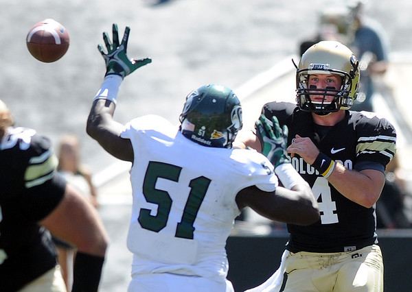 """CU's Jordan Webb tries to get a pass around Avery White of Sacramento State.<br /> For more photos of the game, got o  <a href=""""http://www.dailycamera.com"""">http://www.dailycamera.com</a>.<br /> Cliff Grassmick  / September 8, 2012"""