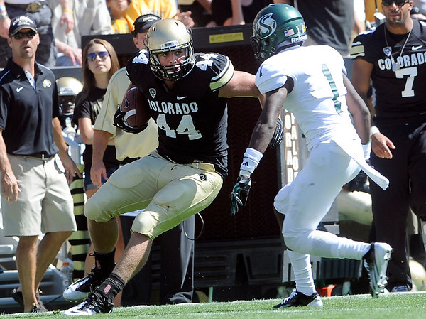 "University of Colorado's Nick Kasa jukes Osagie Odiase after making a catch during a game against Sacramento State on Saturday, Sept. 8, at Folsom Field in Boulder. For more photos of the game go to  <a href=""http://www.dailycamera.com"">http://www.dailycamera.com</a><br /> Jeremy Papasso/ Camera"