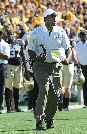 """Colorado coach, Jon Embree, tries to get the attention of the officials.<br /> For more photos of the game, got o  <a href=""""http://www.dailycamera.com"""">http://www.dailycamera.com</a>.<br /> Cliff Grassmick  / September 8, 2012"""