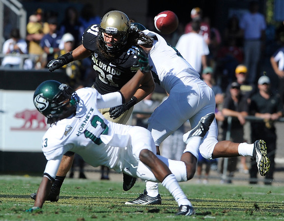 "University of Colorado's Jon Major rushes in to help deflect a pass from Morris Norrise during a game against Sacramento State on Saturday, Sept. 8, at Folsom Field in Boulder. Sacramento State won the game 30-28. For more photos of the game go to  <a href=""http://www.dailycamera.com"">http://www.dailycamera.com</a><br /> Jeremy Papasso/ Camera"