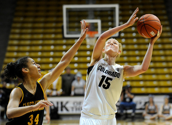 """University of Colorado's Julie Seabrook shoots the ball over San Francisco's Whitney Daniels on Wednesday, Nov. 30, during a game against the University of San Francisco at the Coors Event Center on the CU campus in Boulder. CU won the game 84-66. For more photos of the game go to  <a href=""""http://www.dailycamera.com"""">http://www.dailycamera.com</a><br /> Photo by Jeremy Papasso"""