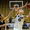 "University of Colorado's Julie Seabrook shoots the ball over San Francisco's Whitney Daniels on Wednesday, Nov. 30, during a game against the University of San Francisco at the Coors Event Center on the CU campus in Boulder. CU won the game 84-66. For more photos of the game go to  <a href=""http://www.dailycamera.com"">http://www.dailycamera.com</a><br /> Photo by Jeremy Papasso"