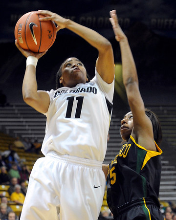 "University of Colorado's Brittany Wilson shoots the ball over San Francisco's Aundrea Gordon on Wednesday, Nov. 30, during a game against the University of San Francisco at the Coors Event Center on the CU campus in Boulder. CU won the game 84-66. For more photos of the game go to  <a href=""http://www.dailycamera.com"">http://www.dailycamera.com</a><br /> Photo by Jeremy Papasso"