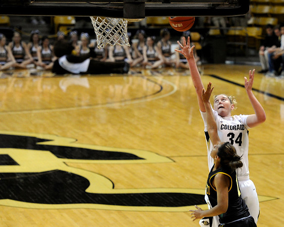 """University of Colorado's Jen Reese drives to the hoop on Wednesday, Nov. 30, during a game against the University of San Francisco at the Coors Event Center on the CU campus in Boulder. CU won the game 84-66. For more photos of the game go to  <a href=""""http://www.dailycamera.com"""">http://www.dailycamera.com</a><br /> Photo by Jeremy Papasso"""