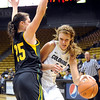 "University of Colorado's Rachel Hargis drives to the hoop past San Francisco's Alicia Scafidi on Wednesday, Nov. 30, during a game against the University of San Francisco at the Coors Event Center on the CU campus in Boulder. CU won the game 84-66. For more photos of the game go to  <a href=""http://www.dailycamera.com"">http://www.dailycamera.com</a><br /> Photo by Jeremy Papasso"