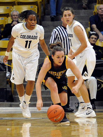 """University of San Francisco's Jamie Katuna recovers a loose ball on Wednesday, Nov. 30, during a game against the University of San Francisco at the Coors Event Center on the CU campus in Boulder. Katuna is a Longmont High School graduate. CU won the game 84-66. For more photos of the game go to  <a href=""""http://www.dailycamera.com"""">http://www.dailycamera.com</a><br /> Photo by Jeremy Papasso"""
