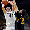"University of Colorado's Jen Reese shoots a two-pointer over San Francisco's Katy Keating on Wednesday, Nov. 30, during a game against the University of San Francisco at the Coors Event Center on the CU campus in Boulder. CU won the game 84-66. For more photos of the game go to  <a href=""http://www.dailycamera.com"">http://www.dailycamera.com</a><br /> Photo by Jeremy Papasso"