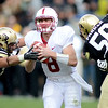 """Stanford QB, Kevin Hogan, is pressured by Brady Daigh, left, and Juda Parker, both of CU.<br /> For more photos of the game, go to  <a href=""""http://www.dailycamera.com"""">http://www.dailycamera.com</a>.<br /> Cliff Grassmick / November3, 2012"""