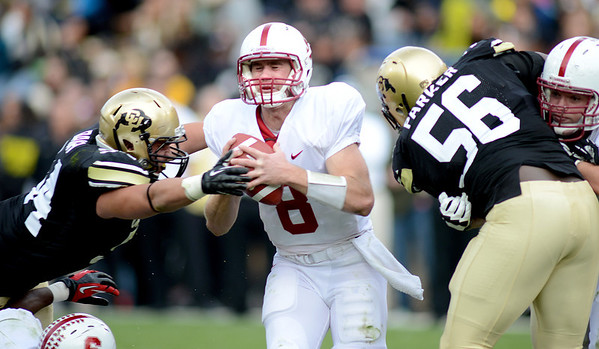 "Stanford QB, Kevin Hogan, is pressured by Brady Daigh, left, and Juda Parker, both of CU.<br /> For more photos of the game, go to  <a href=""http://www.dailycamera.com"">http://www.dailycamera.com</a>.<br /> Cliff Grassmick / November3, 2012"