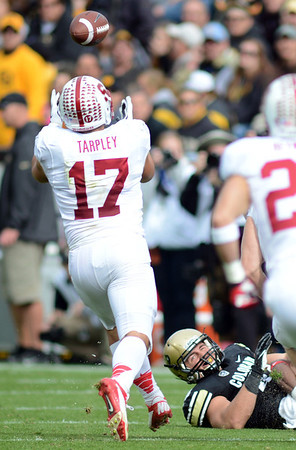 """A.J. Tarpley of Stanford grabs an interception after a ball was knocked out of the hands of Nick Kasa, bottom.<br /> For more photos of the game, go to  <a href=""""http://www.dailycamera.com"""">http://www.dailycamera.com</a>.<br /> Cliff Grassmick / November3, 2012"""