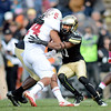 "Marques Mosley, right, of CU, tackles Patrick Skov of Stanford.<br /> For more photos of the game, go to  <a href=""http://www.dailycamera.com"">http://www.dailycamera.com</a>.<br /> Cliff Grassmick / November3, 2012"