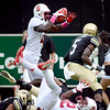 """Jamal-Rashad Patterson of Stanford goes airborne trying to score against CU.<br /> For more photos of the game, go to  <a href=""""http://www.dailycamera.com"""">http://www.dailycamera.com</a>.<br /> Cliff Grassmick / November3, 2012"""
