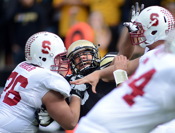 "Kevin Danser of Stanford keeps Samson Kafovalu of CU away from Kevin Hogan.<br /> For more photos of the game, go to  <a href=""http://www.dailycamera.com"">http://www.dailycamera.com</a>.<br /> Cliff Grassmick / November3, 2012"