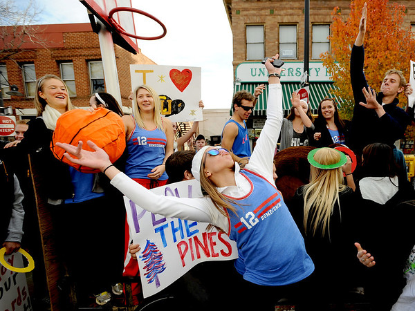 "Annie McNeill dances to music during the CU Homecoming Parade judging on Saturday.<br /> The 2012 CU Homecoming Parade was held on The Hill  on November 3, 2012.<br /> For more photos of the game and the parade, go to  <a href=""http://www.dailycamera.com"">http://www.dailycamera.com</a>.<br /> Cliff Grassmick / November3, 2012"