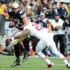 "Alex Carter of Stanford hits Nick Kasa of CU causing a fumble.<br /> For more photos of the game, go to  <a href=""http://www.dailycamera.com"">http://www.dailycamera.com</a>.<br /> Cliff Grassmick / November3, 2012"