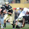 """Connor Wood of CU looks to hand off against Stanford.<br /> For more photos of the game, go to  <a href=""""http://www.dailycamera.com"""">http://www.dailycamera.com</a>.<br /> Cliff Grassmick / November3, 2012"""