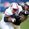 "Stepfan Taylor  of Stanford is tackled by Paul Vigo of CU.<br /> For more photos of the game, go to  <a href=""http://www.dailycamera.com"">http://www.dailycamera.com</a>.<br /> Cliff Grassmick / November3, 2012"