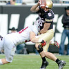 """Trent Murphy of Stanford Pressures Nick Hirschman of Colorado on Saturday.<br /> For more photos of the game, go to  <a href=""""http://www.dailycamera.com"""">http://www.dailycamera.com</a>.<br /> Cliff Grassmick / November3, 2012"""