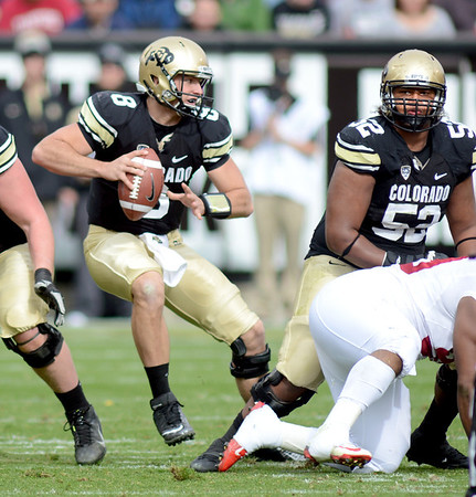 "CU QB, Nick Hirschman, moves around in the pocket against Stanford.<br /> For more photos of the game, go to  <a href=""http://www.dailycamera.com"">http://www.dailycamera.com</a>.<br /> Cliff Grassmick / November3, 2012"