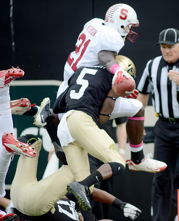 "Jamal-Rashad Patterson of Stanford goes airborne trying to score against CU.<br /> For more photos of the game, go to  <a href=""http://www.dailycamera.com"">http://www.dailycamera.com</a>.<br /> Cliff Grassmick / November3, 2012"